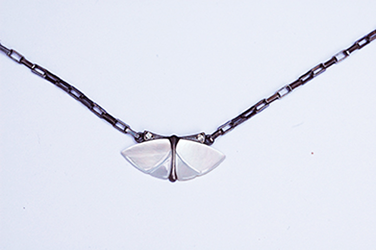 Sterling silver chain and body, blackened, mother of pearl wings, white diamonds on the antenna