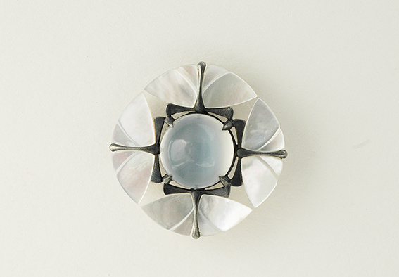 pendant in sterling silver, blackened, with mother of pearl wings, and a large moonstone cabochon