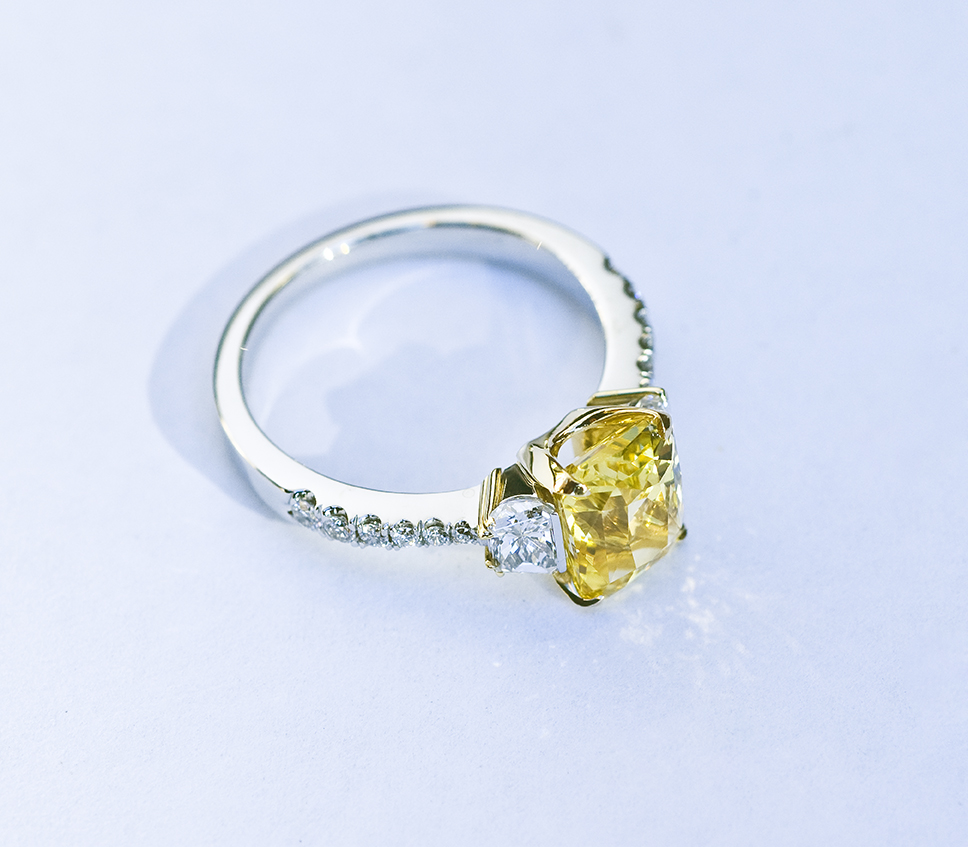 yellow sapphire, emerald cut, trapezoid white diamonds, platinum and yellow gold engagement ring made in Santa Barbara for DGG