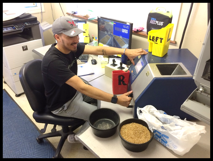 Jose Correa-Moya Testing Turkey Red Wheat for Moisture and Protein;   CHS Elevator; Pasco, Washington