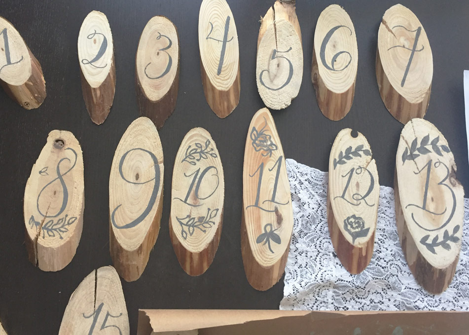 wood slice hand-calligraphed, hand-lettered table numbers