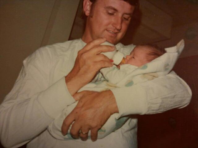Me and Daddy. I was a day old.