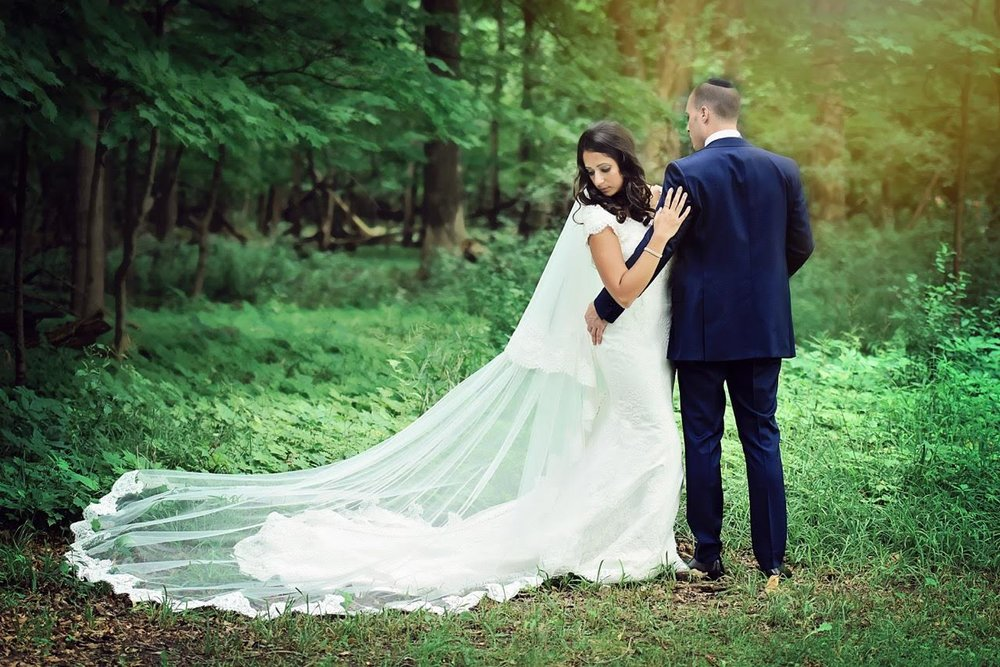See Melinda's gorgeous modest lace gown and cathedral length veil  Thanks to Melinda and  Samantha Jensen of Alicia's Photography   for allowing us to share these images.