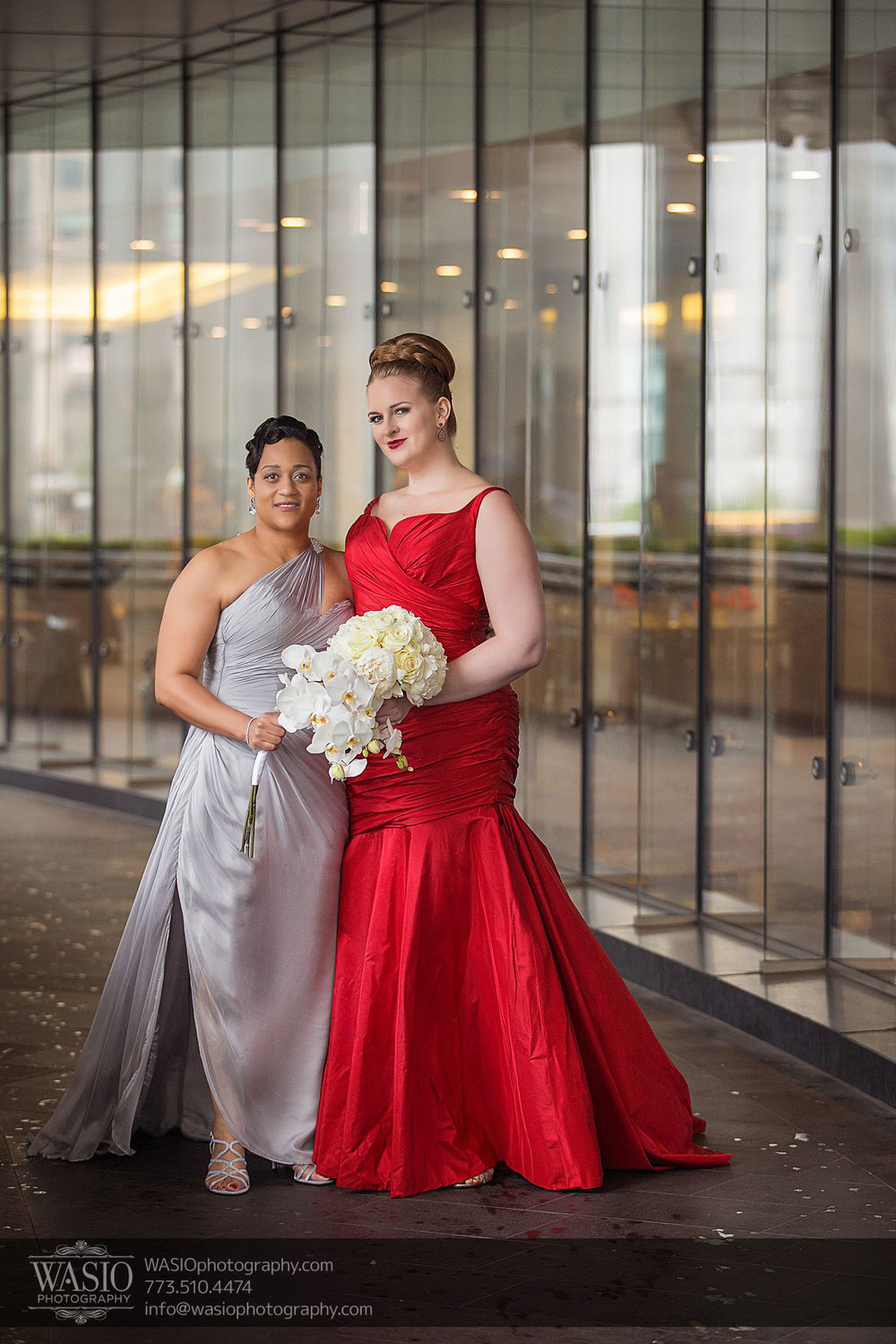 See Olivia and Givonna's red carpet worthy silver and red wedding gowns.  Thanks to Olivia and Givonna and  Wasio Photography  for allowing us to share these images.