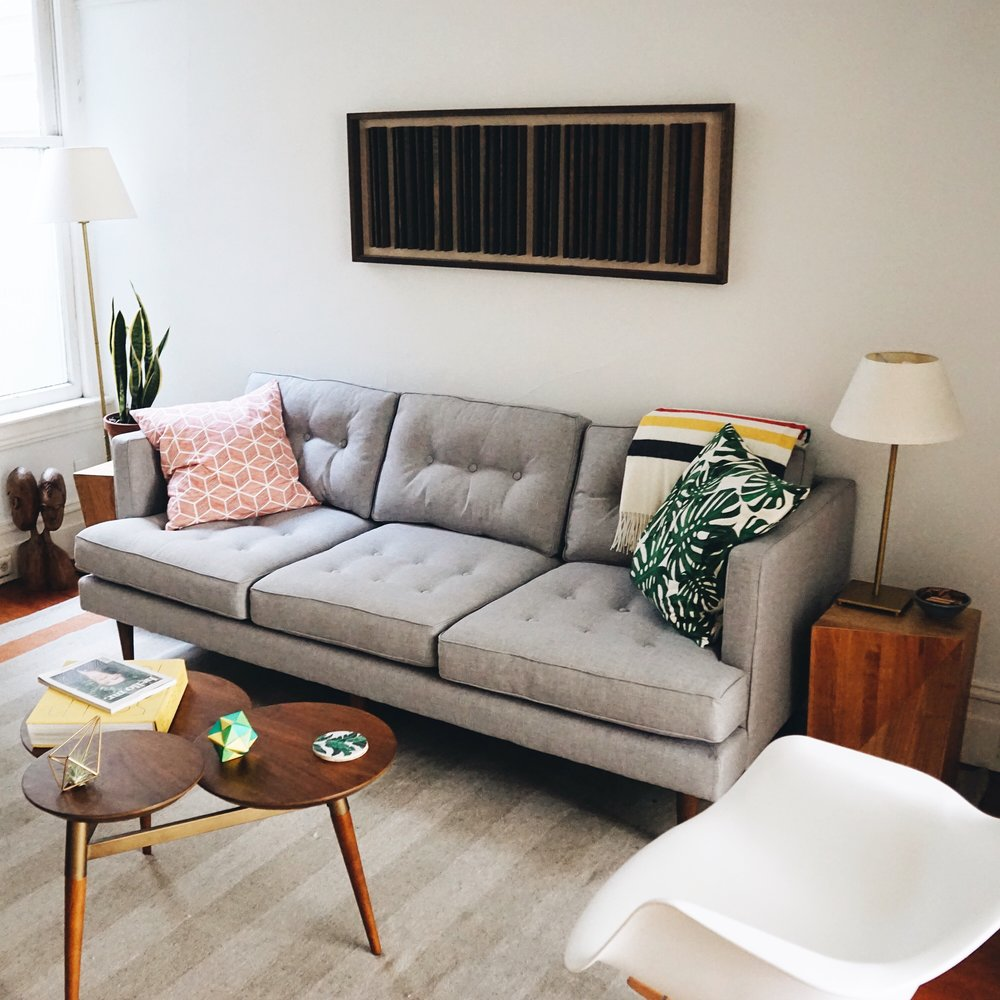 Our cozy little living room. We just got this new couch and I love its mid century style. We were couch-less for awhile and it was pretty rough. It also fits in perfectly with one of my favorite @tylernagayama wood installation pieces.