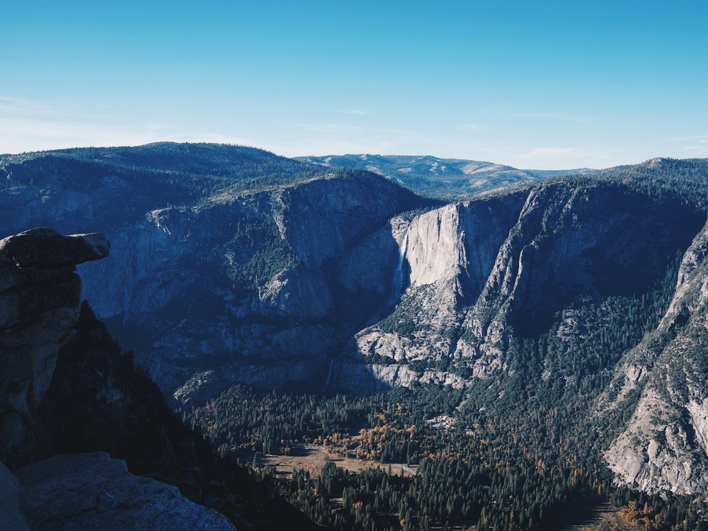 Wow. Hanging rock at Glacier Point. In the far distance is a waterfall if you can spot it.
