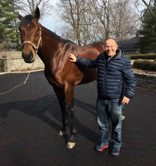 Triple Crown announcer Larry Collmus with American Pharoah on a recent trip to Ashford Stud. Collmus was behind the mic during American Pharoah's Triple Crown and Breeders' Cup Classic wins.