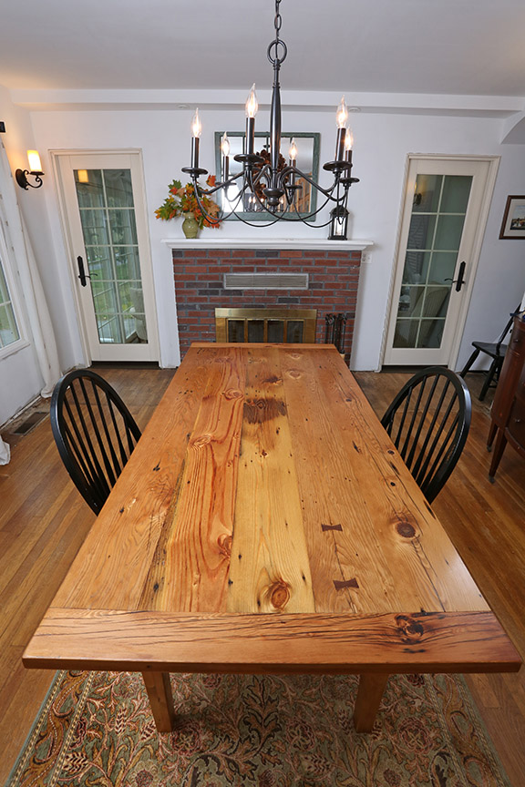 The breadboard ends on the table help to keep the tabletop flat while still allowing it to expand and contract with seasonal changes.