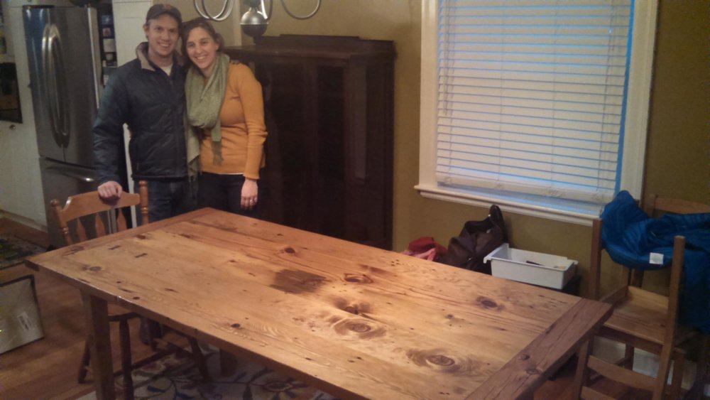 My clients (the recipient's parents) delivered the table to their daughter in Massachusetts and sent me this picture of her and her fiancé with the table in its new home.