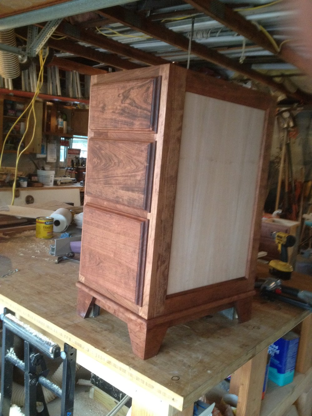 The end panel on each drawer base is a cherry veneer, left unstained to provide contrast to the rest of the piece.