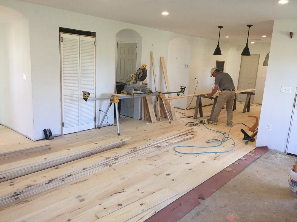 New floors being installed in the kitchen and living room.