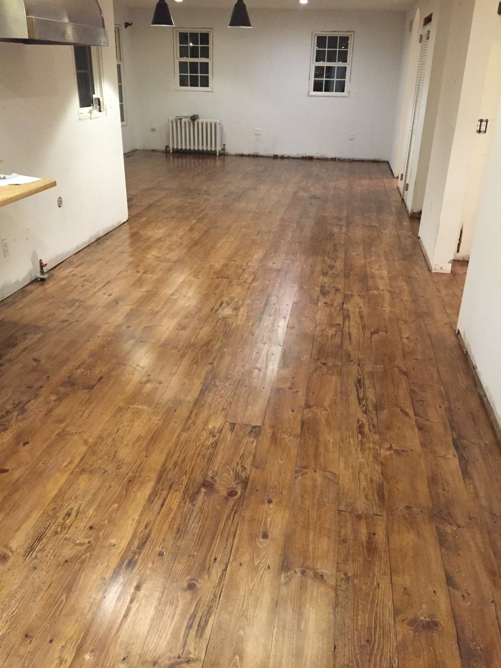 After staining and a few coats of polyurethane, the floors were finished.