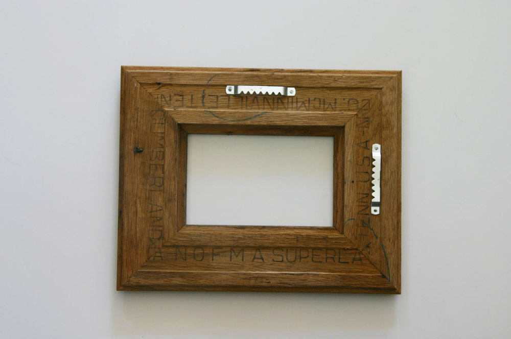 Hardware on the back of each frame allows for hanging it in either direction.
