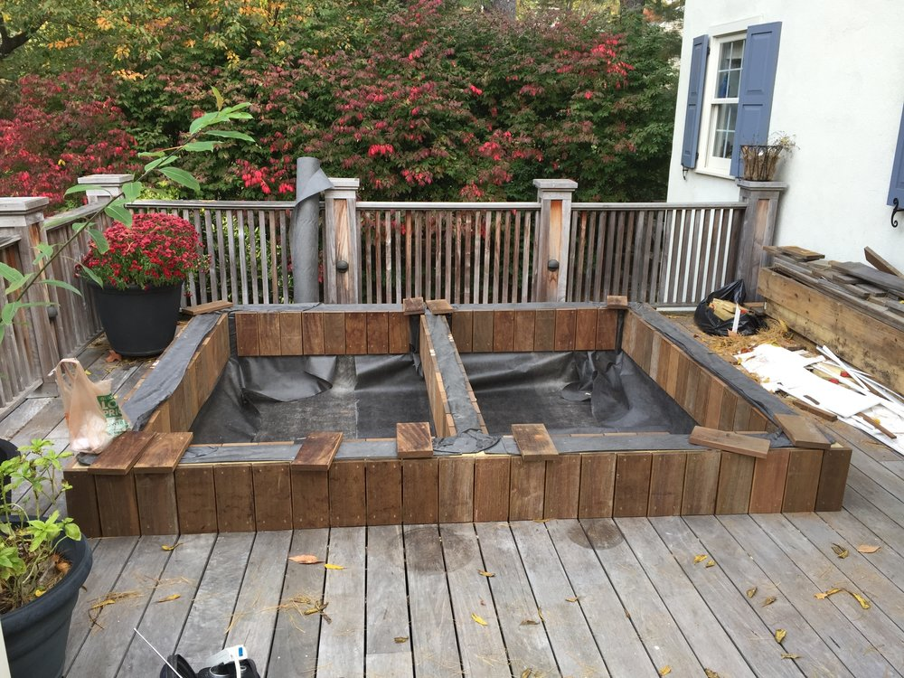 After lining the interior with filter fabric, I applied ipe deck boards to the exterior and interior walls so that they would line up exactly with the existing decking. Over time,they will weather to the same silver color as the rest of the decking.