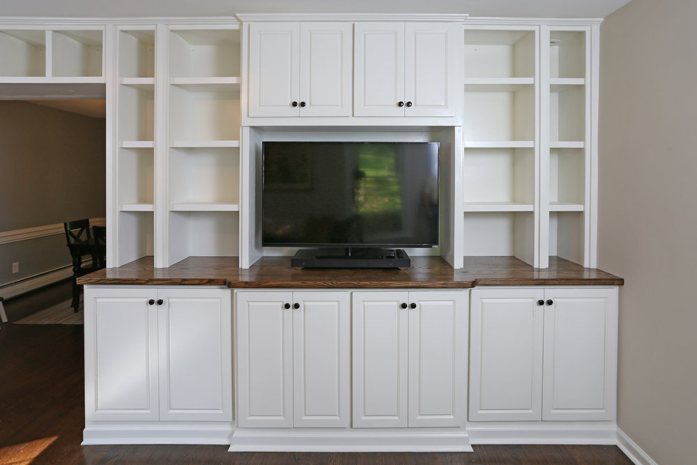 They also wanted an area to house their TV and other electronics. I designed that area to extend forward beyond the adjacent cabinets to provide visual interest.