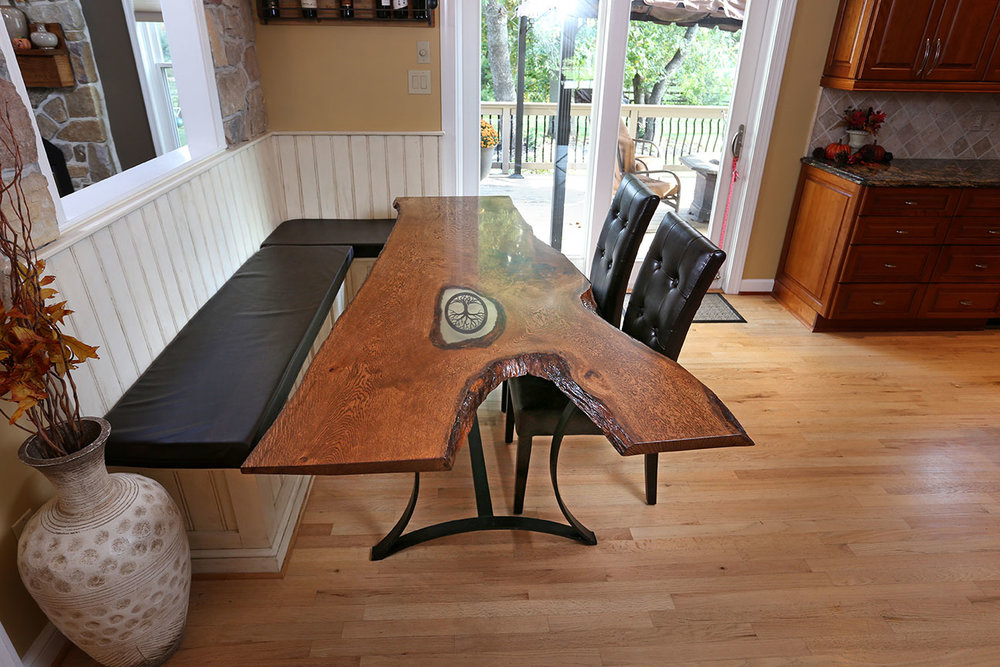The client had custom cushions made for the bench tops, shown here alongside the live edge white oak table I made as part of the  overall project .