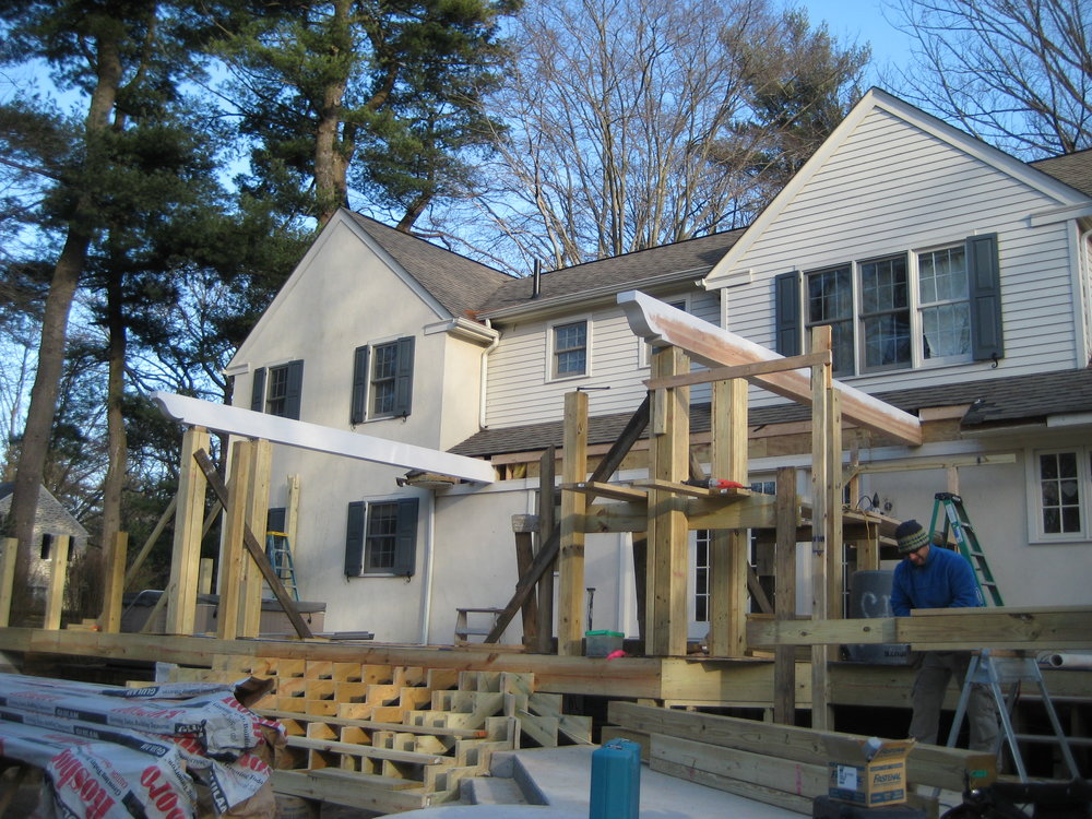 Installing the large main beams for the pergola