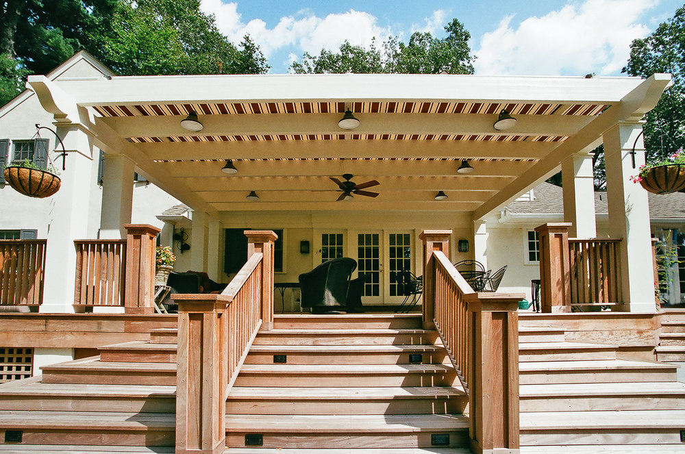 The pergola has a retractable canopy on it to provide shade from the summer sun.