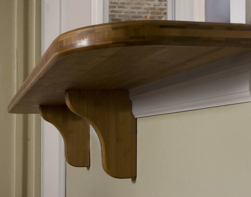 The breakfast bar in the dining room has custom-built bamboo corbels.