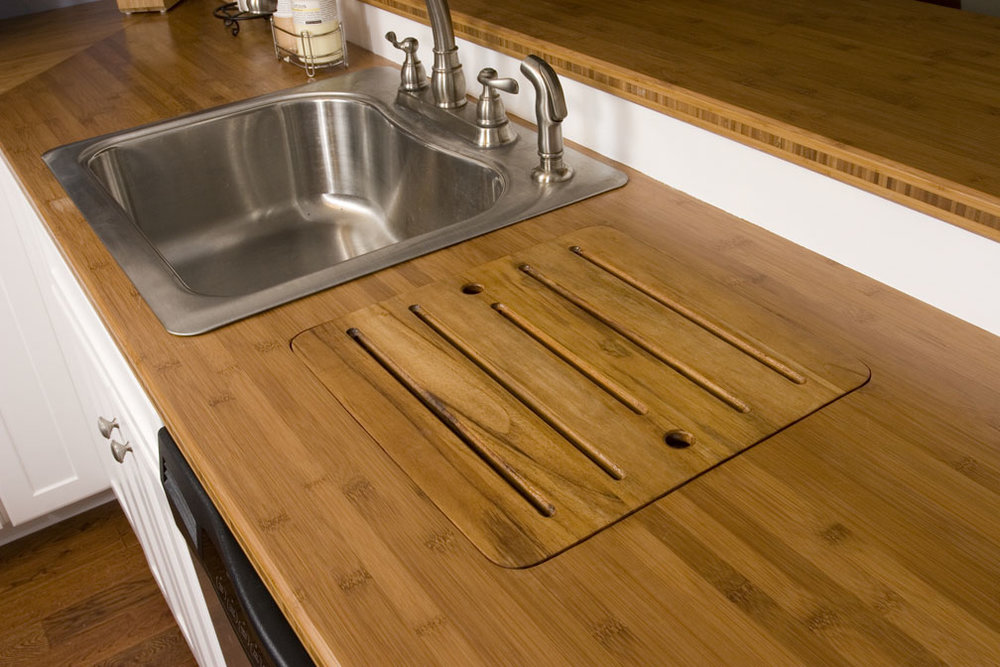 Teak drainboard next to sink for drying dishes