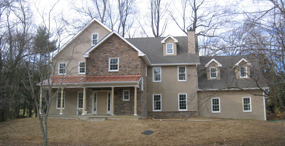 This is a custom house we built in 2007. While the photogragh is a little drab because it was winter, it's the only time of year to see the whole house because the leaves are off the trees.