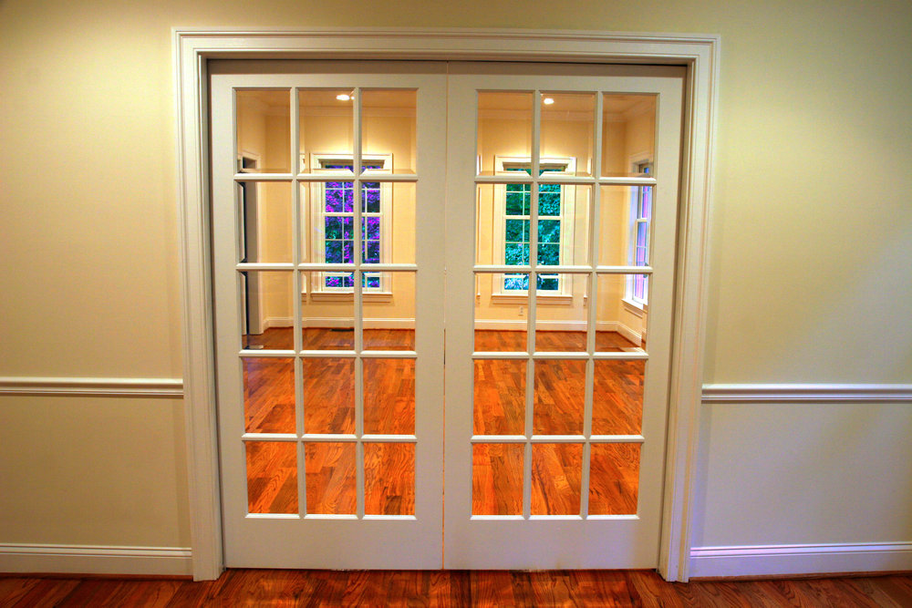 French pocket doors between the formal living room and the dining room