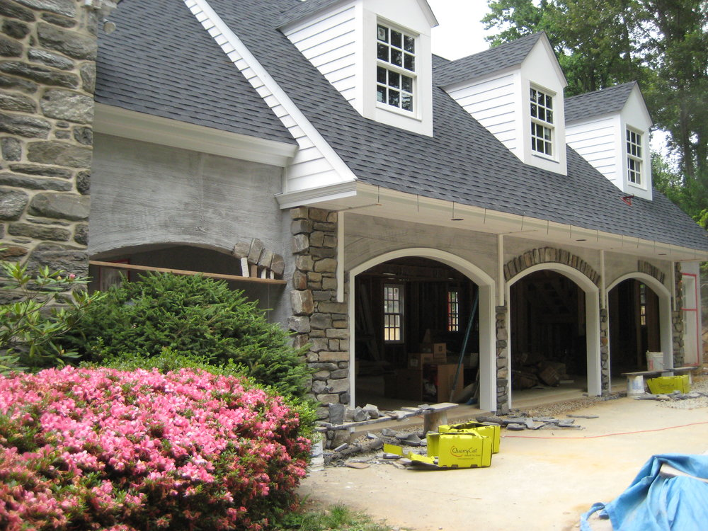 We took stone from the original house that was obtained during the second floor demolition to attach the addition and used it on the exterior of the new garage to help blend it into the original structure.