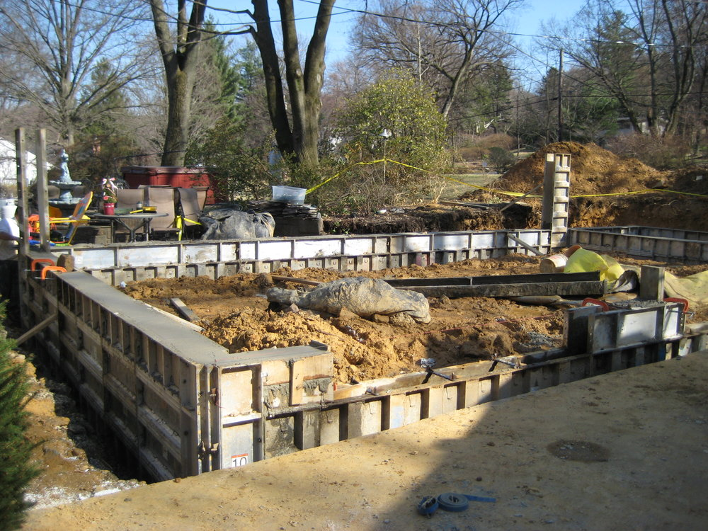 A client came to us for a garage addition on their 1920's stone home. The job eventually expanded into including a patio and pool deck for a new pool they had installed while we were working with them. Here the garage foundation walls are going in.