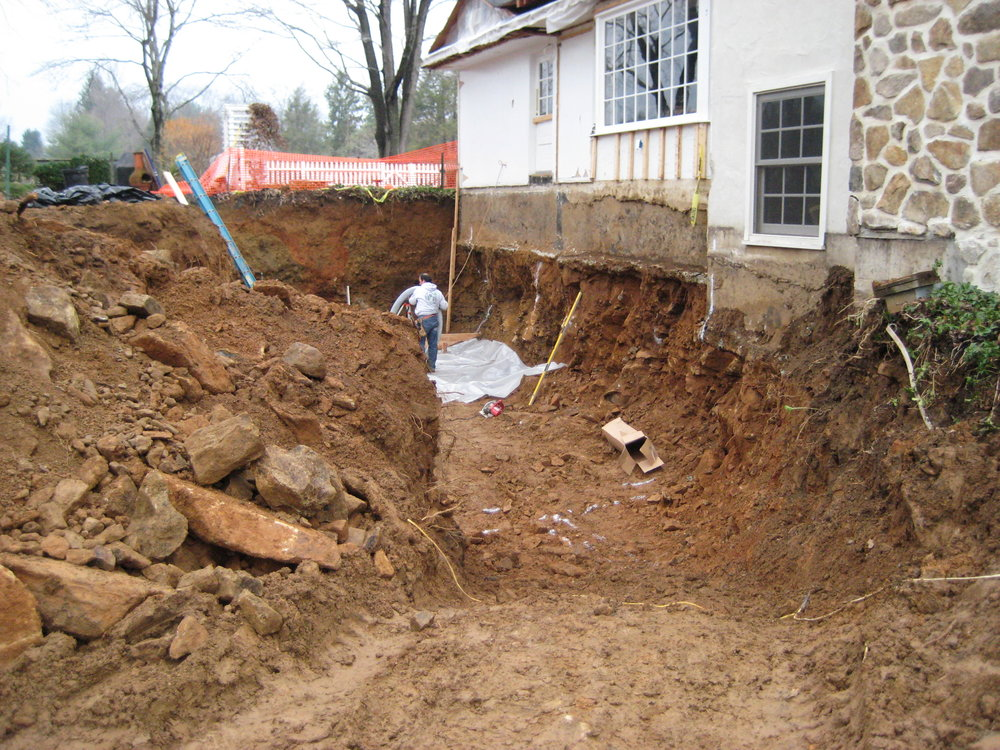 The original house didn't have a full basement, but the new addition would. This required us to excavate below the foundation of the main house.
