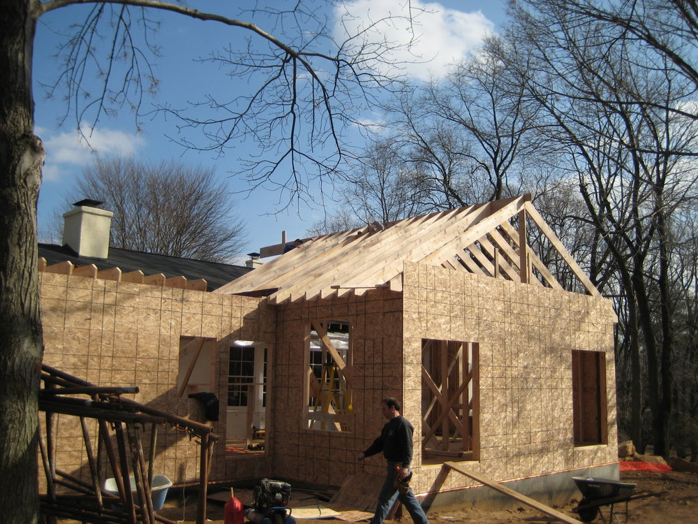 Walls going up and roof framing