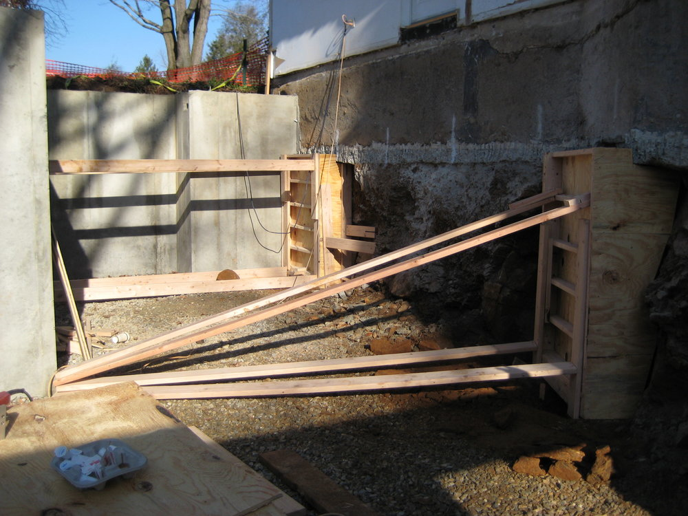 Underpinning forms - since we excavated below the foundation of the existing house, we now needed to support it. This was done by pouring a concrete wall in small sections underneath the existing foundation; each section is tied together with rebar to make the finished wall a solid unit.