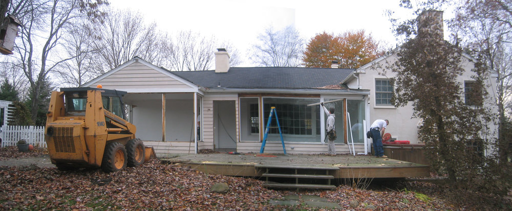 "This job was brought to us by a fellow contractor who wanted us to build the outer shell of this addition. Once it was up and weather-tight, he would complete the interior renovations. ""Before"" picture of original sunroom and deck during the initial stages of demolition."