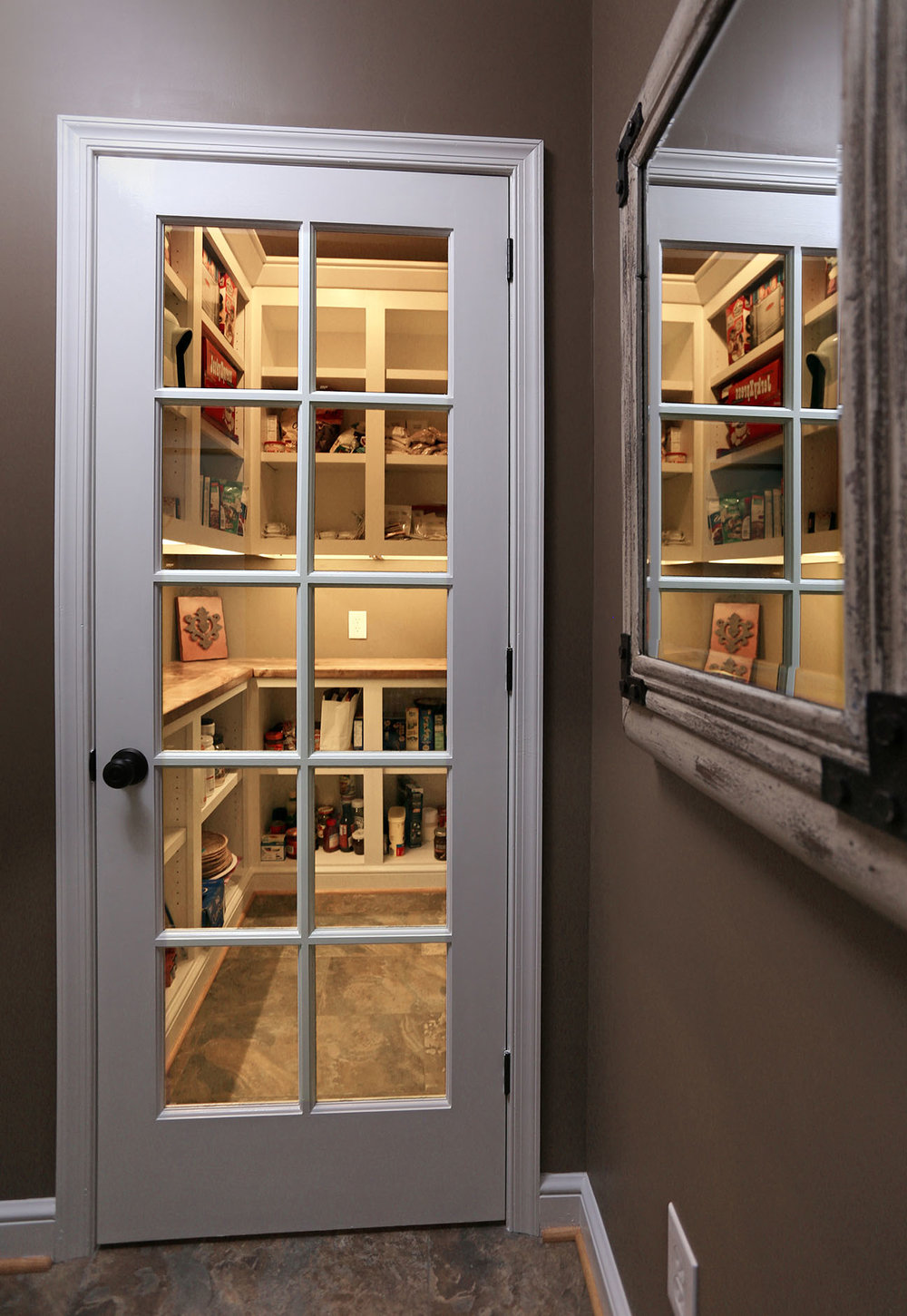 Just off the mudroom is a pantry that I fit out as the second half of this project. The pantry has a 10-lite french door and an occupancy sensor that turns on the overhead and under-cabinet lights automatically.