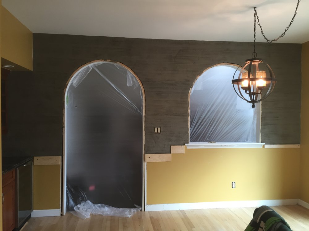 To begin the stonework, we removed the drywall and installed tar paper and wire mesh over a plywood backing. After that, a brown coat was installed which serves as a base layer for the stone.