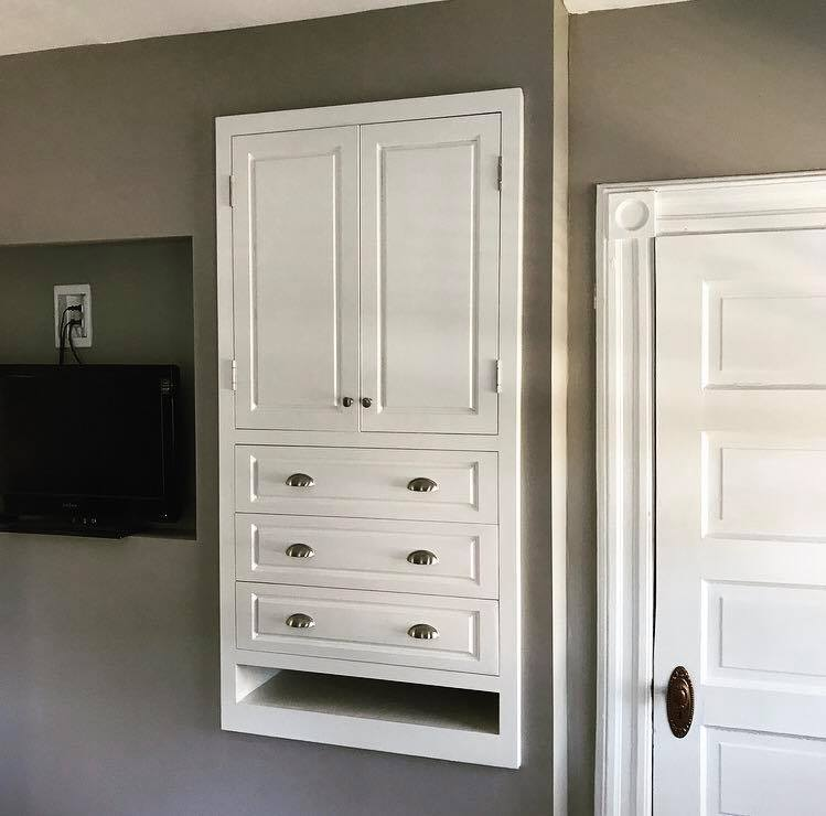 This project came to me from an old college friend who was looking for a built-in cabinet to provide more storage space in his early 1900's Folk Victorian home. We worked together on a design that would provide him with the storage space he required while blending into the existing trim scheme and decor of the home.