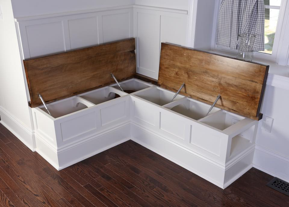 The bench tops have concealed Soss hinges and open up for additional storage space inside.