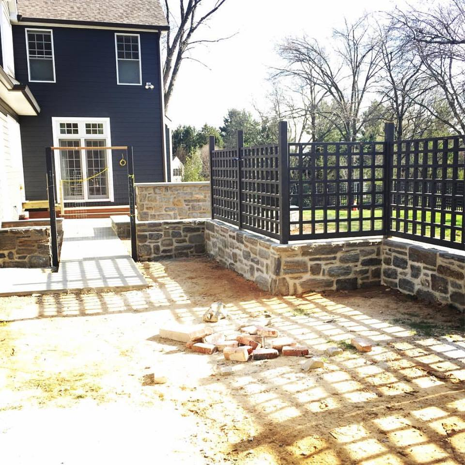 After the masons were finished with their work, I was able to come back and install the final sections of fence that sat atop the walls.