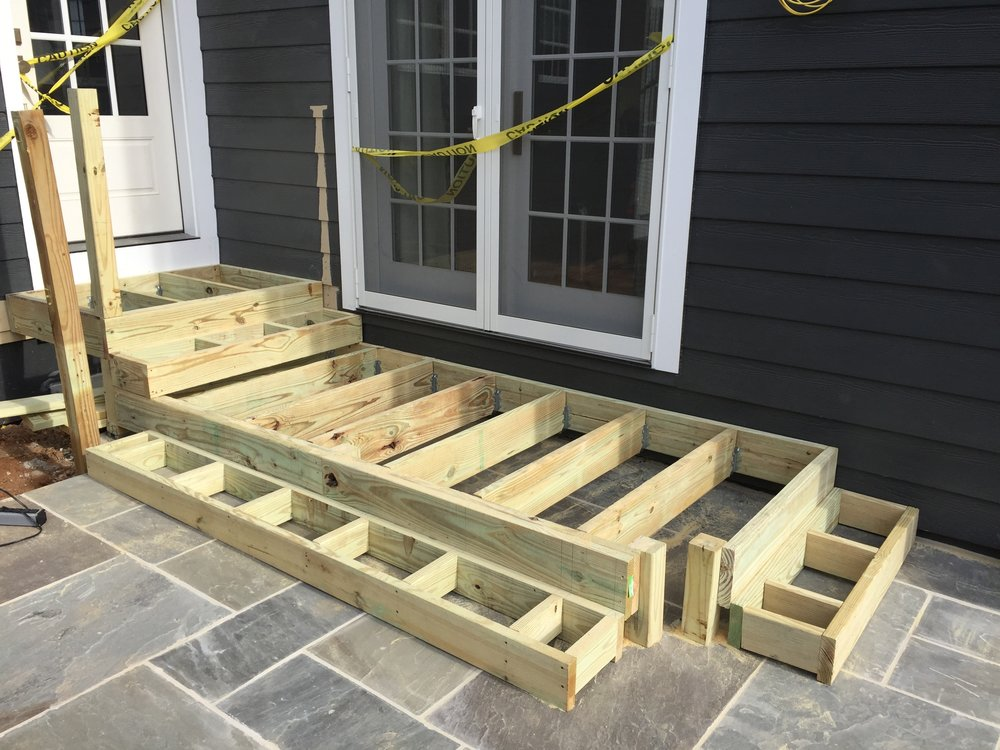 The main framing is installed. The open framing at the corners is where the steps will curve around.