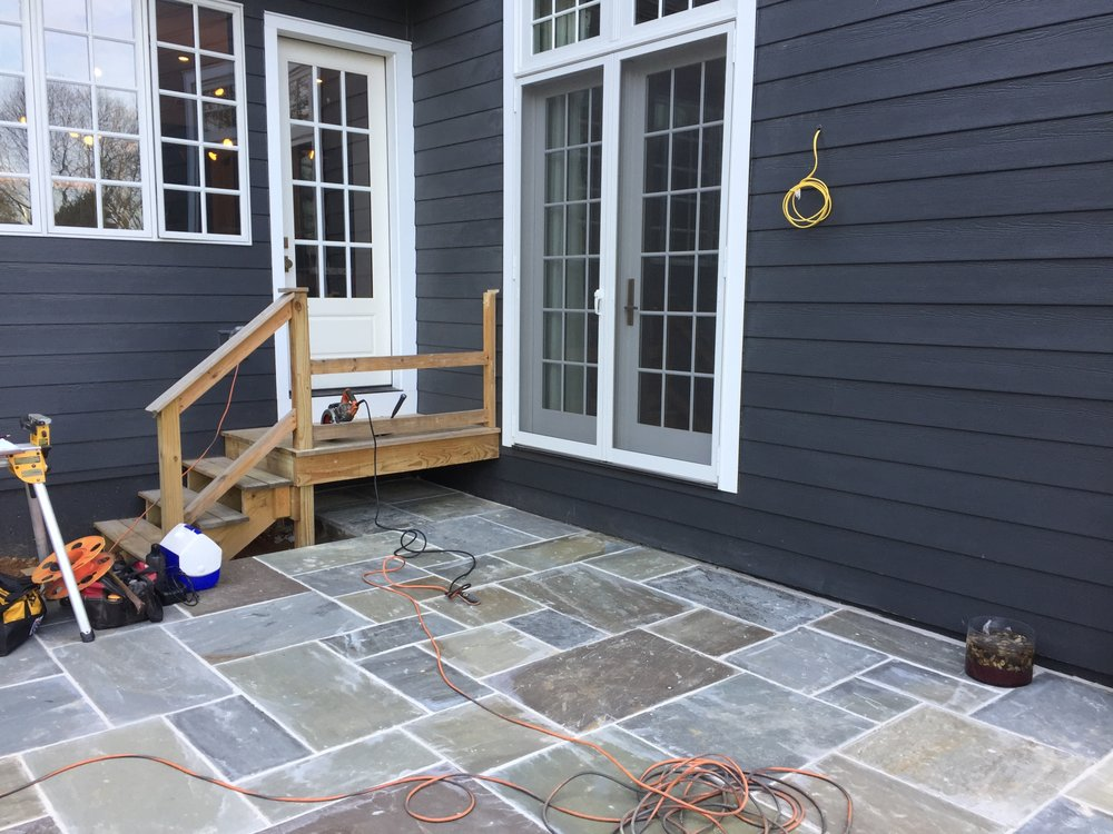 This client wanted to get rid of the rear staircase that was left over from construction on their home. I worked with them on developing a design for a small ipe deck to provide a landing area outside their doors.