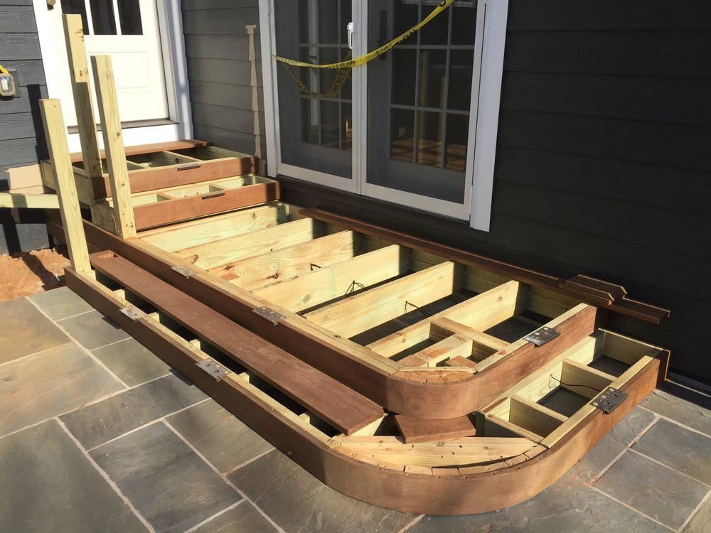 Here, the risers and necessary framing have been installed, and I'm starting to install the decking.