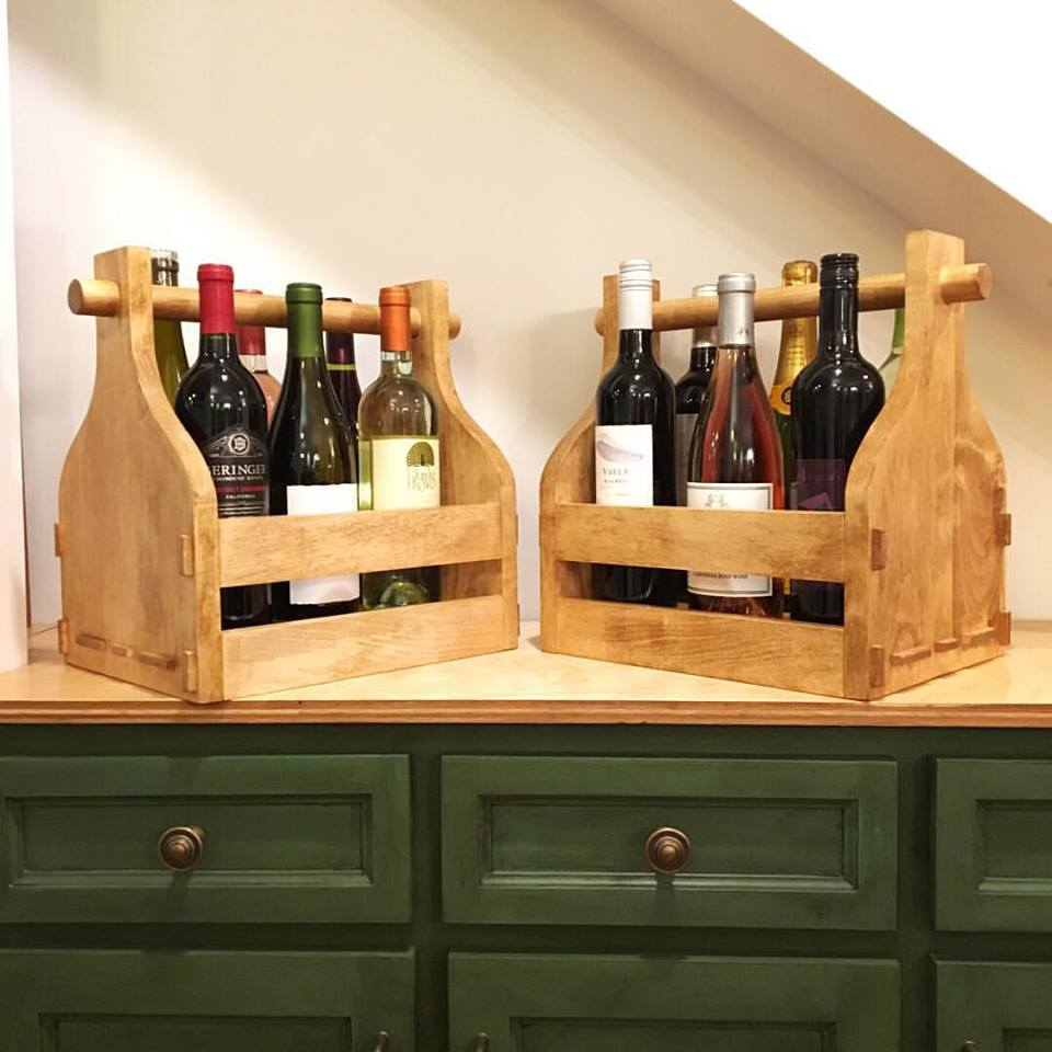 The finished pair of wine carriers ready to be auctioned off. Each one is made of solid maple with through-tenon joinery, and the bottoms are also set into grooves along the lower rails for additional strength.