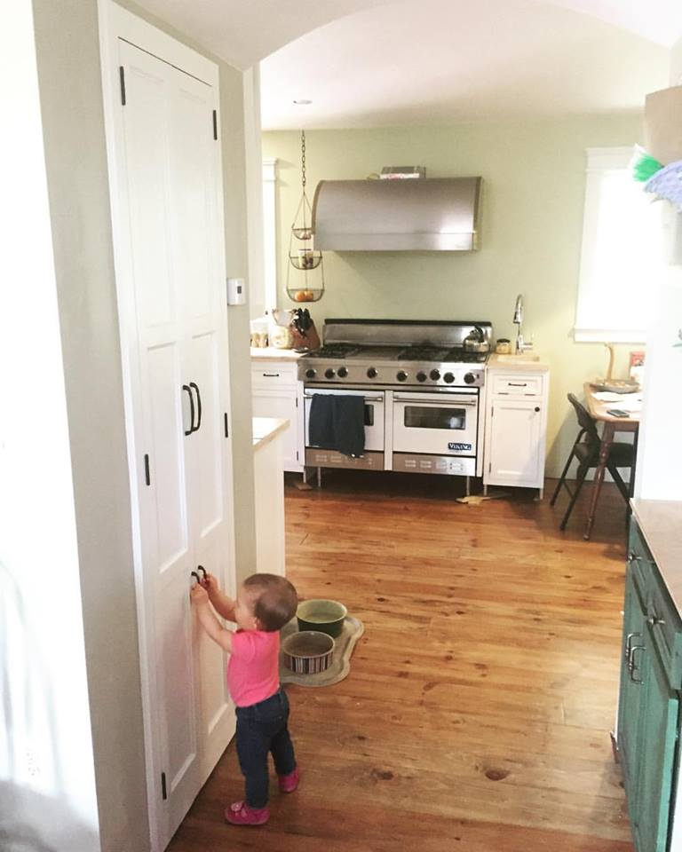 When I installed handles on the trash cabinet doors, I also installed a smaller pair down low for my kids to use. Here my younger daughter tests them out.
