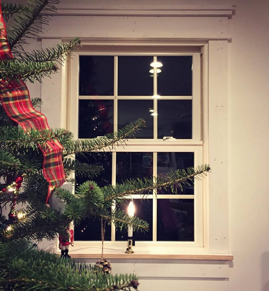 Just before Christmas 2016 I installed window trim throughout the house. In this picture they still need nail holes filled and a coat of paint, but now that we had windowsills we could finally use our electric window candles for the holidays.