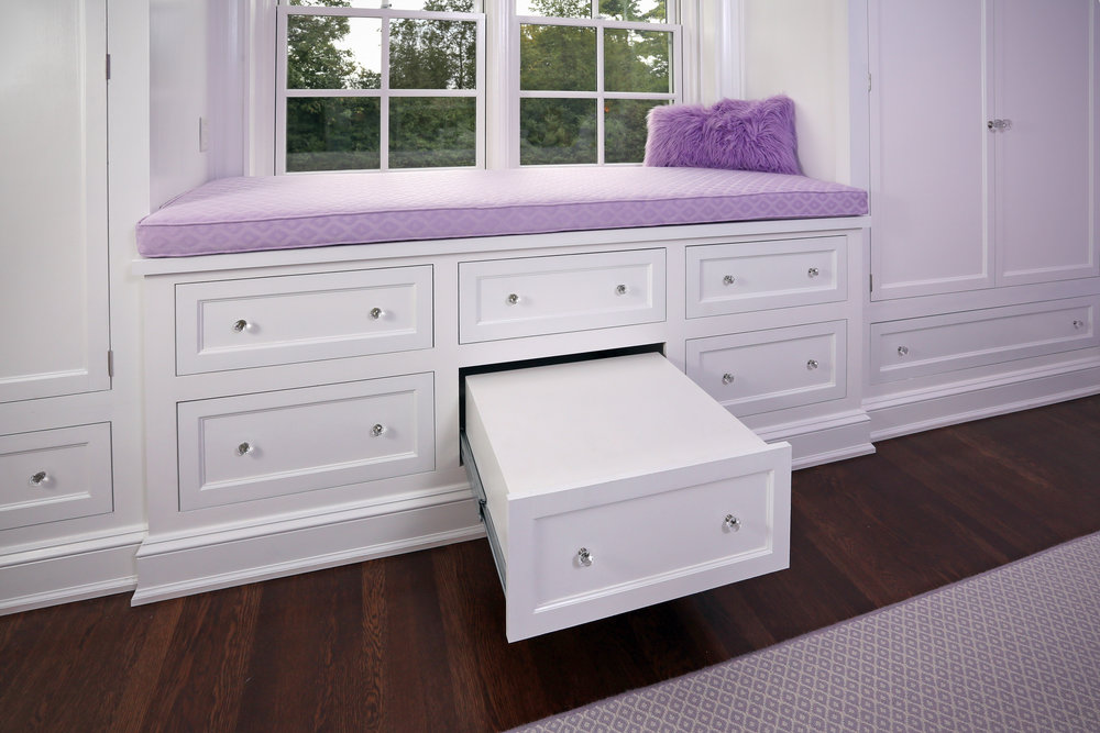 The torsion box from earlier serves as a false drawer that provides a step up to the extra tall window seat.