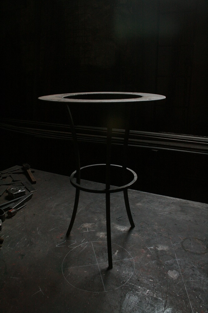 I designed this simple metal base for the table and my friend John Parker of The Painted Garden, Inc fabricated it for me.