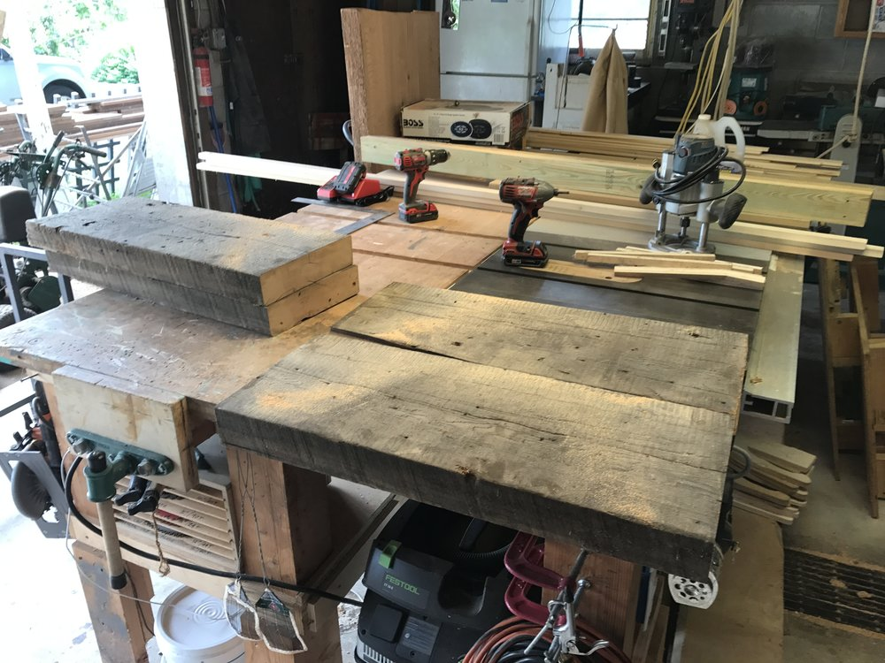 The beams weren't wide enough to span the table base, so i joined up two pieces for the top and two for the shelf, keeping the cut sides in the middle so that the existing patina was retained.