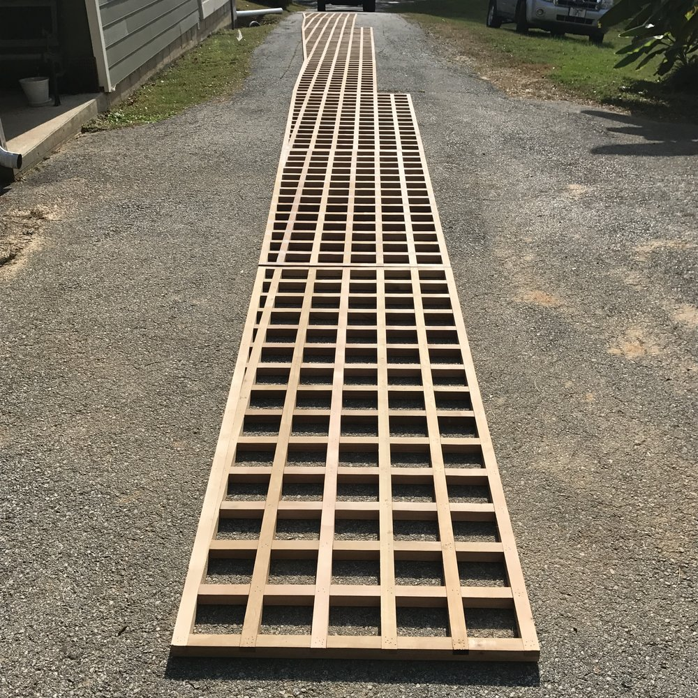 All the panels laid out end to end on my driveway to check their alignment.