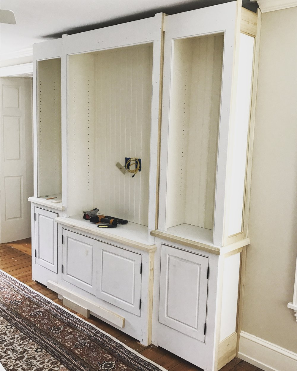 After the upper cases were set, doors were hung, and the end panels were installed my part of this job was complete. The clients would handle the installation of the crown molding and baseboards, as well as installing the pulls and painting.