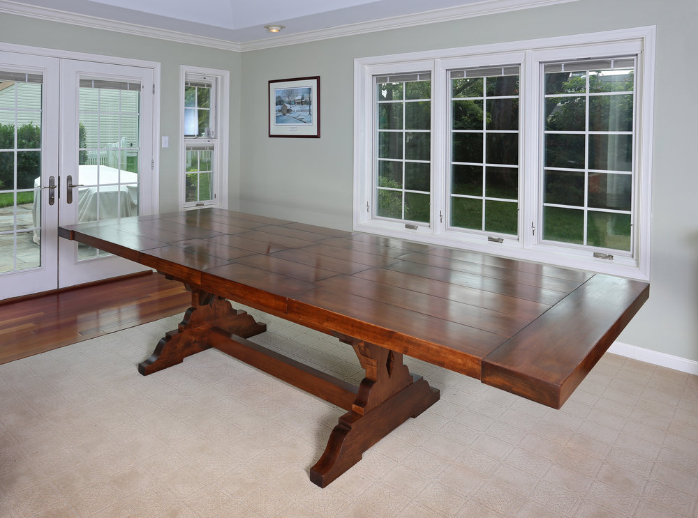 "With both leafs in place, the table is 48"" wide by 120"" long and can seat eight to ten people."