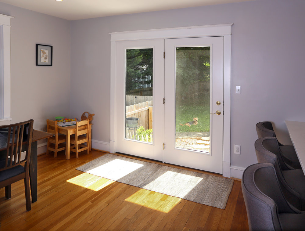 The new atrium door that replaced the original dining room window allows more natural light into the room as well as access to the backyard. .